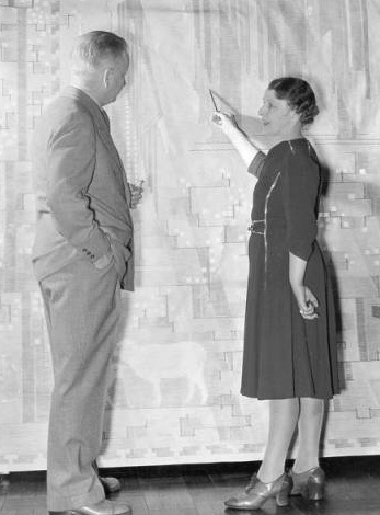 Loja Saarinen showing Eliel a cartoon of their tapestry, Sermon on the Mount, for Tabernacle Church of Christ (now First Christian Church in Columbus, Ind.), 1941. Courtesy of  Cranbrook Archives